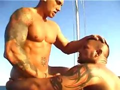 Muscled hunks fuck on a boat