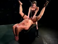 Prodomme pegging her restrained sub