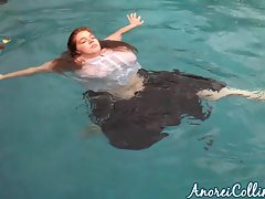Huge slutty girl goes swimming fully clothed
