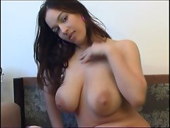 Top heavy dark haired toys her massive knockers