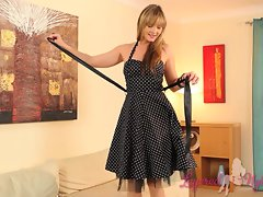Doll strips of her polka dot dress and masturbates