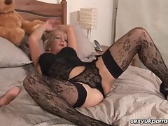 Attractive mature English pornstar Jane Bond rubber toy play stockings