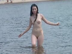Nudist friends bare together at the beach