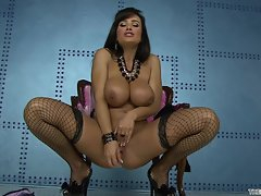 Top heavy Lisa Ann rams her rubber toy deep in her dripping slot