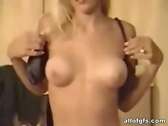 Sensual light-haired stripping and showing body