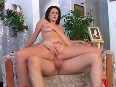 Dark haired young woman rides dick with her puckered pooper