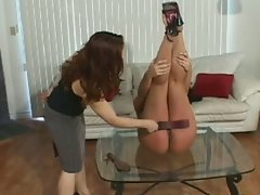 Mistress spanks her slave's butt