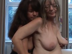 Seductive mom lezzies rub and touch each other