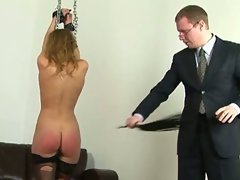 Hand tied dark haired punished with ass spanking