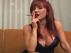 Redheaded mommy smokes and accepts a ramming