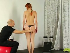 Gagged redhead does what she's told