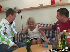Party fellows make grandma a penis sandwich