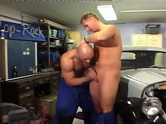 Muscled hunk bareback in the garage
