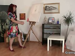 Redhead granny paints naked subjects
