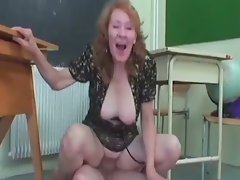 Strict teacher spanks her student