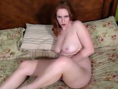 Chesty redhead lass talks obscene while banging