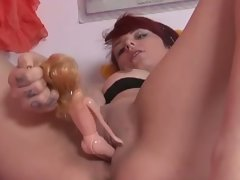 Amateur punk inserts doll in her cunt