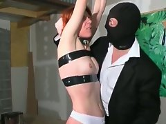 Masked man tortures experienced redhead