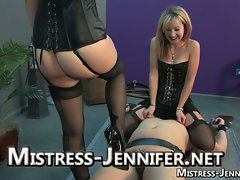 Two mistresses play with their sex slave