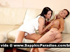 Beauteous dark haired lezzies kissing and having lezzy sex on the couch