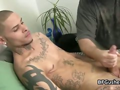 Tattooed dude gets his wild penis jerked part3