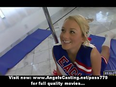 Seductive cheerleader exercising and flashing panties and doing cock sucking