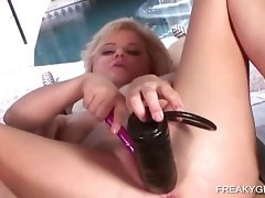 Light-haired toy banging her lusty vagina