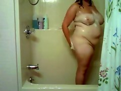 plumper chick in bathroom play with her snatch