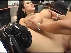 Chesty dark haired with shaven vagina in stripper boots