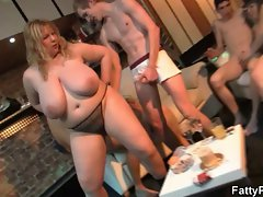Plump blond rides and strokes penis at party