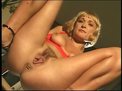 Lewd short hair blond on table fingering snatch stoops and urinates
