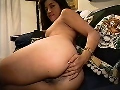 Curvy latina cutie plays with spiky toy on couch