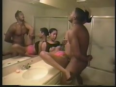 Young lady caresses chaps pecker on the bathroom counter