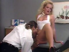 Big hair tempting blonde gets grinded from behind in doctor's office