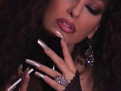 Aged Dark haired teasing in pantyhose, long nails, smoking