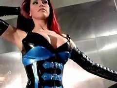 Redhead posing solo in shocking rubber