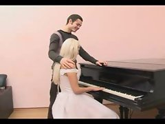 Banging the bride that sits at the piano