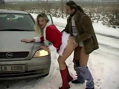 Girl in Christmas outfit shagged on the side of the road