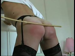 Young lady in stockings caned on her naughty ass