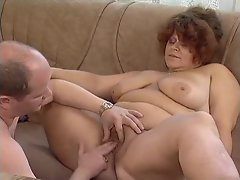 Buxom dude bangs a plumper redheaded whore