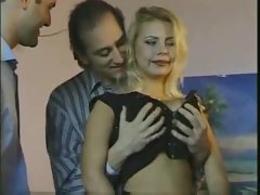 Three men bang a tempting blonde in stockings