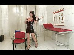 Nurse in latex dress showing mega big melons