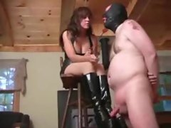 Young lady in rubber dress abuses his prick