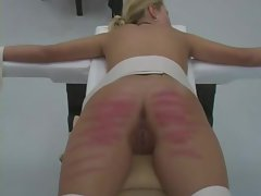 19yo females are strapped to a table and caned