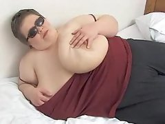 Cute bbw playing with her enormous boobs