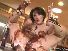Nude bony gal covered in chocolate sauce