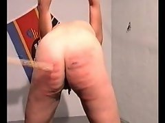 Caning her butt leaves painful marks