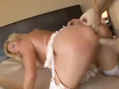 Experienced in beautiful pinkish lingerie receives xxl big cock
