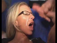 Mum in glasses is soaked in cum