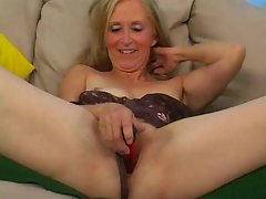 Experienced in black lingerie toys her fresh pussy